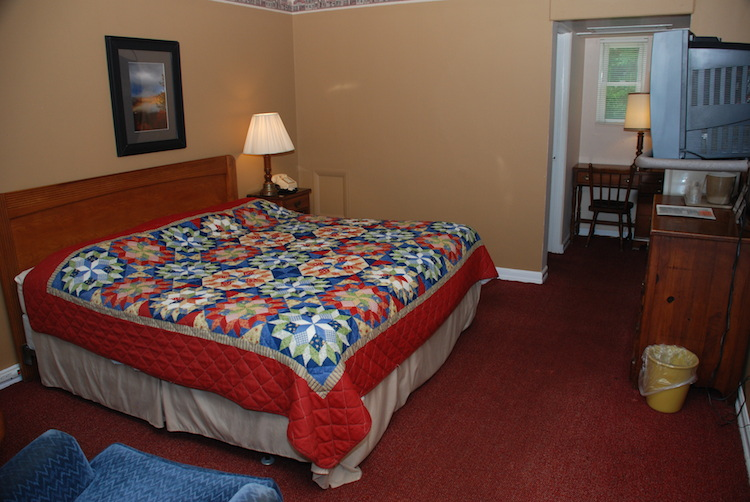 King Room bed with patterned quilt