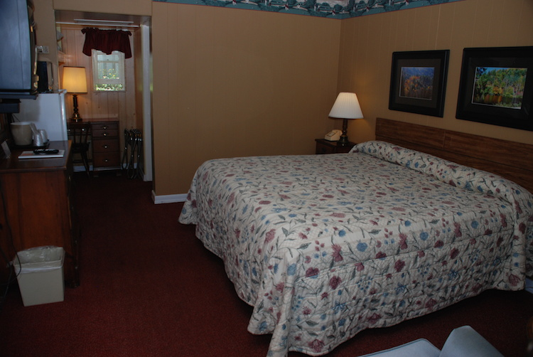 King Room bed with white flowered quilt