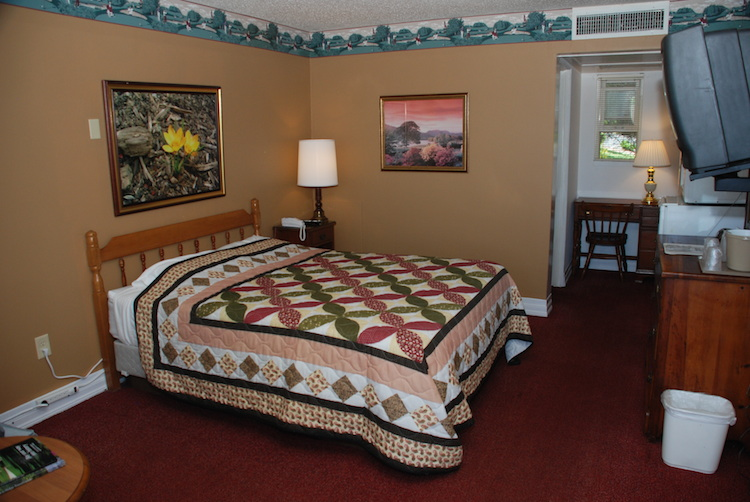 Queen Room Bed with patterned quilt