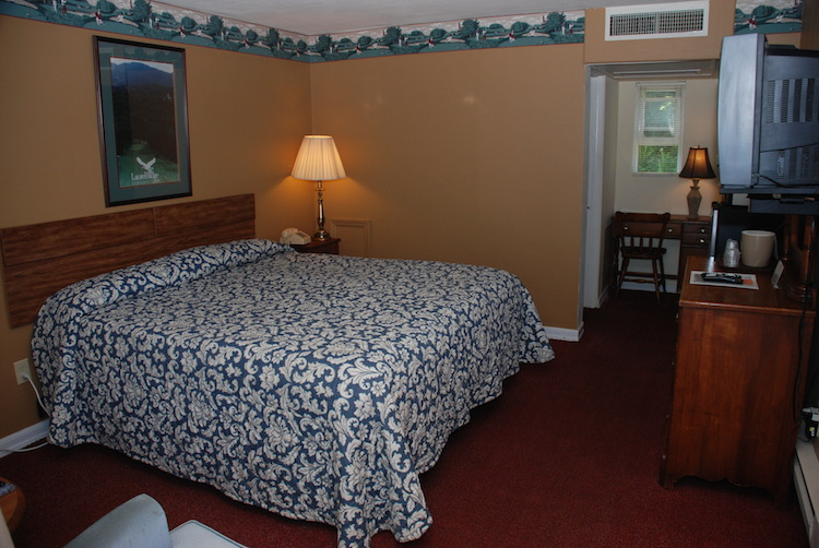 King Room bed with blue flowered quilt
