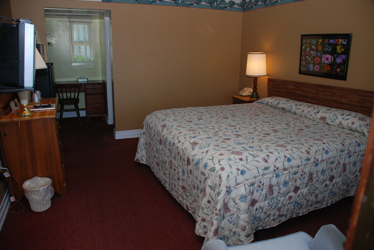 King Room bedroom with white flowered quilt