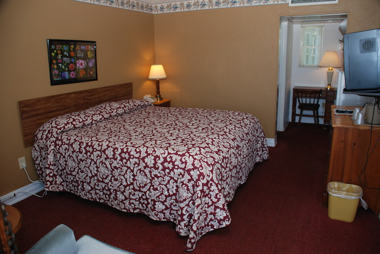King Room bed with red flowered quilt